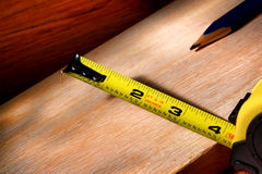 Construction Tape Measure on Carpentry Wood Board Stock Images
