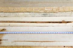 The construction tape measure rests on wooden boards. Construction, repair Stock Photo