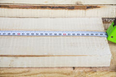The construction tape measure rests on wooden boards. Construction, repair Royalty Free Stock Photos