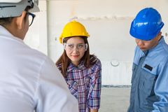 Construction team, Architect, Engineer and Foreman discussing. In Building Construction site as Real Estate Project Development Concept stock photos