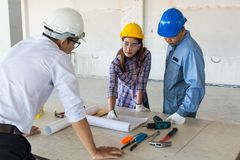 Construction team, Architect, Engineer and Foreman discussing. In Building Construction site as Real Estate Project Development Concept Stock Photography
