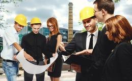 Construction team at business meeting Stock Photos
