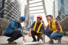 Construction team check paper blueprint plan stock photo