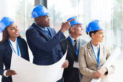 Construction team discussing Royalty Free Stock Photo