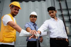 Construction Team gather hands for teamwork. Harmonious Team of Engineering manager, field engineer, foreman gather hands togerher to work and cheer up at royalty free stock images