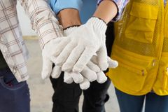 Construction Team Handshake or Join Hand of People. In Real Estate Project Development as Teamwork Collaboration or United together by Multiethnic Diverse Group stock photos