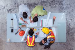 Construction team work, They`re talking about new project, Top v. Construction team work, They`re talking about new project. , Top view royalty free stock photography