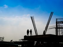 Silhouette of construction workers. stock photos