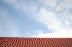 Construction texture the roof tile of the house pattern Background Blue Sky stock photography