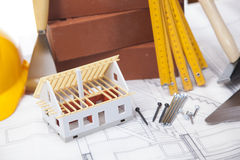 Construction theme on blueprints Royalty Free Stock Photography