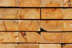 Construction Timber Background: Cutting Edges of Piled Pine Thick Boards. Cutting edges view of a thick baords` pile consisting of pine wood custruction timber stock photos