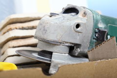 Construction tool angle grinder for cutting tile Stock Images