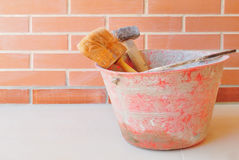 Construction tool. And a brick wall Royalty Free Stock Image
