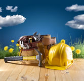 Construction tool and helmet on blue nature background Stock Photos