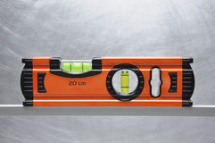 Construction tool spirit level. On line of metal profile Royalty Free Stock Photography