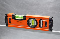 Construction tool spirit level. On line of metal profile Royalty Free Stock Photo