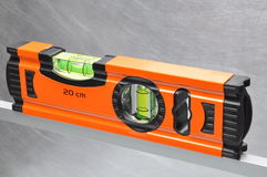 Construction tool spirit level. On line of metal profile Stock Photography