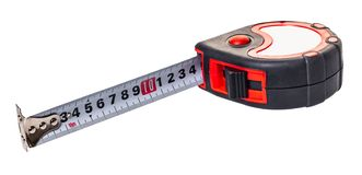 Construction tool, tape measure. On white isolated background stock photo