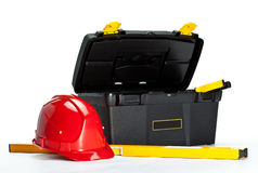 Construction toolbox, level and red hardhat Royalty Free Stock Photos