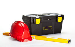Construction toolbox, level and red hardhat Royalty Free Stock Images