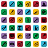 Construction tools black icons set on a color square. Vector industrial signs collection. Construction tools black icons set on a color square. Vector Royalty Free Stock Photos