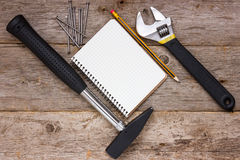 Construction tools and blank notebook Royalty Free Stock Image