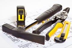 Construction tools and blueprint Stock Photos