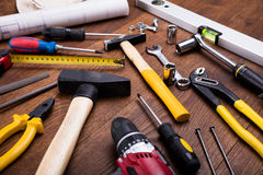 Construction Tools With Blueprint On Desk Stock Photos