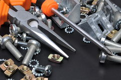 Construction tools and bolts Stock Photo