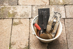 Construction tools or construction equipment with bucket on bric Royalty Free Stock Photos