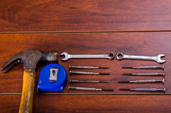 Construction tools,Flat wrenches, hammer, tape measure on wooden background Royalty Free Stock Photos