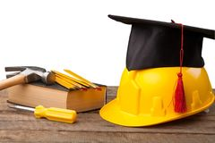 Construction tools and a graduate hat. Skill apprenticeship graduate academic achievement apprentice stock images