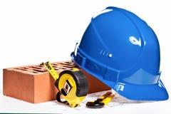 Construction tools, hardhat, brick and blueprint Stock Photos