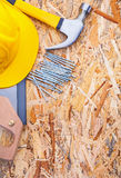 Construction tools helmet handsaw claw hammer Royalty Free Stock Photography