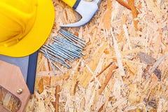 Construction tools helmet handsaw claw hammer Stock Photo