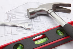Construction tools with house blueprint Stock Photos