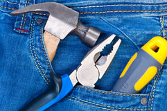 Construction Tools In Pocket Jeans. Royalty Free Stock Photos