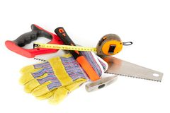 Construction tools isolated on white background. Protection gloves and construction tools isolated on white background Stock Photo