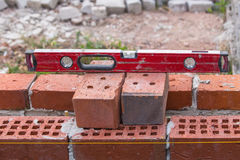 Construction tools at the level of the brickwork Stock Image