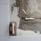 Construction tools notched trowel with mortar Stock Photo