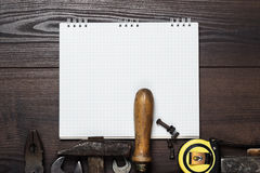 Construction tools and notepad on wooden Stock Photo