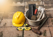 Construction tools or safety equipment with yellow helmet on bri Stock Photo