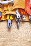 Construction tools in toolbelt nippers pliers Stock Photography