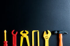 Construction tools toy on black background with copy space.Home royalty free stock photos