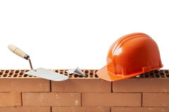 Construction Tools on a Wall of Bricks Stock Image