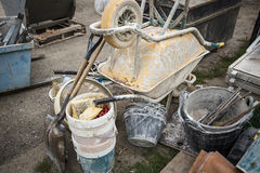 Construction tools - wheelbarrows, Building shovels, Buckets and scaffoldings Stock Images