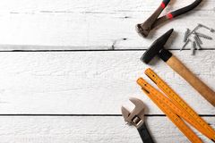 Construction tools on white wood background with copy space Stock Images