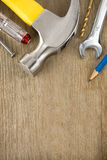 Construction tools on wood background stock images