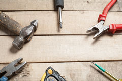 Construction tools on wooden background. Copy space for text. Set of assorted work tool at wood table . Top view Stock Image