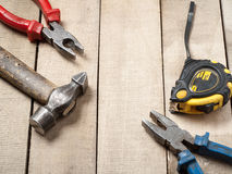 Construction tools on wooden background. Copy space for text. Set of assorted work tool at wood table . Top view. Construction tools on wooden background. Copy royalty free stock photo